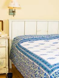 french country interiors blue bed sheets hand block printed