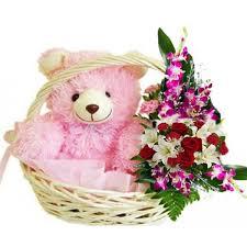flowers arrangement 1 height teddy sitting in flower basket with mix flower