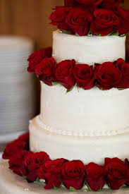 red and white wedding cakes with decorating of party