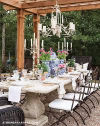 Wrought Iron Outdoor Chandelier Whimsical Garden Features A French Style Concrete Dining Table