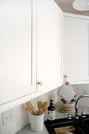 how to turn kitchen cabinets into shaker style how to add trim and paint your laminate cabinets brepurposed