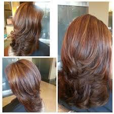 putting layers in shoulder length hair medium length hair cut with layers blown out with big round brush