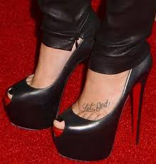 12 celebrities that love showing off their foot tattoos