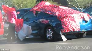 car wrapped in wrapping paper shows rob cover parked cars in wrapping paper