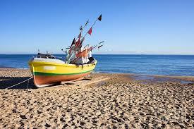 Baltic Weekender Festival by Fishing Boat At Baltic Sea Beach Photograph By Artur Bogacki