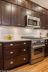 white backsplash dark cabinets like the gas stove oven i also like the light floors with the dark