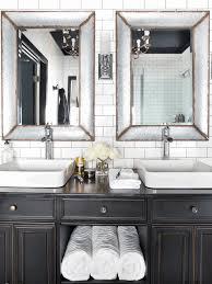 bathroom with white tiles porcelain undermount sink mirror a black