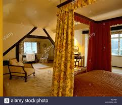 Attic Bedroom by Yellow Attic Bedroom With Floral Curtains On Fourposter Bed And