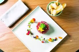 tamis fin cuisine nikkei style tuna tartare with yuzu pepper gel flava cayman
