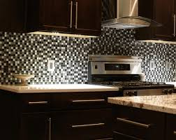 kitchen with stainless steel backsplash pictures of stainless steel backsplash black wooden countertop