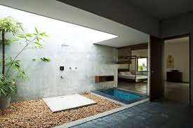 Sunken Bathtub Big Bamboo Pot With Brown Pebbles And Wall Mounted Shower Head