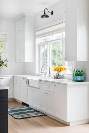 white kitchen cabinets with farm sink white shaker cabinets and farm sink with black vintage
