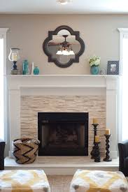 vintage wall mirror above stone fireplace designs with white
