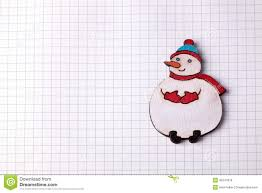 handmade wood christmas decoration snowman on squared paper stock