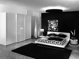 white wooden bed with white black floral bed sheet placed on the