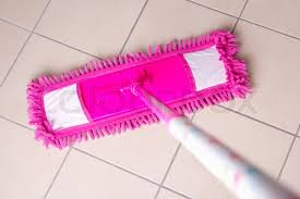pink mop cleaning tile floor in bathroom stock photo colourbox