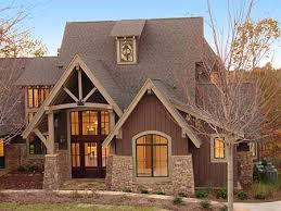 Craftman Home Plans by Elegant Timbering Stone And Expansive Windows Hint At What U0027s In