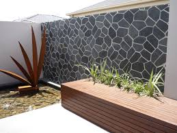 an outdoor feature wall in onyx really stands out backyard