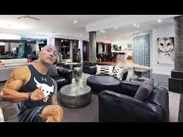 the biography of dwayne johnson dwayne johnson the rock lifestyle net worth salary houses