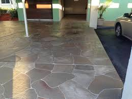 Tiling A Concrete Patio by Painted Concrete Patio With Travertine Cement Tiles In The Front