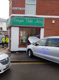 warning for drivers as car crashes into chinese takeaway after