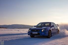 subaru wrx drift car drifting on icy roads from norway to lapland