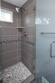 grey porcelain tile was chosen for the floor shower walls and