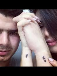 and king of hearts black finger tattoos couplestattoo