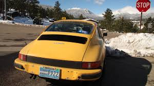 porsche signal yellow porsche 912e hero colorado jpg quality u003d85
