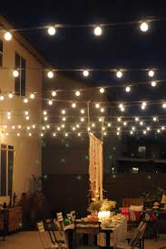 outdoor lights stringing lights a table creates a ceiling and turns a