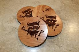wooden raccoon coasters with raccoon engraved on maple or cherry