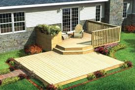 Patio Designs Under Deck by Brown Wooden Patio Deck With Wooden Railing And Stair Plus Green