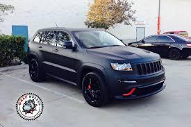 custom black jeep jeep srt8 wrapped in 3m deep matte black vehicle wrap wrap bullys
