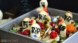 zombie cookies top this graveyard brownie cake for a creepy