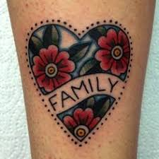 american traditional mom heart tattoo with floral accents ink