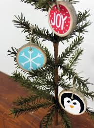 give your christmas tree a natural look using wood slices painted