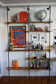 How To Make A Pipe Bookshelf Lovely Imperfection Diy Pipe Shelf Lovely Imperfection