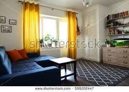 clean family room blue couch white stock photo 598202447