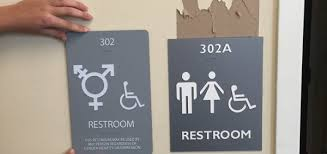 gender neutral bathroom signs ripped down in the campus y