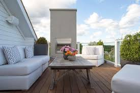 Deck Coffee Table - outdoor armless sofa with gray trellis pillows transitional