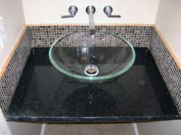 bright bathroom design filled with glass bowl sink also stainless