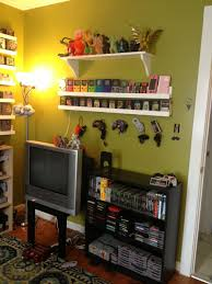 home design game videos gamer builds room to display her retro video game collection