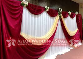 wedding backdrop setup burgundy and gold background headtable setup
