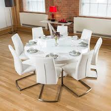 large round white gloss dining table lazy susan 8 white chairs