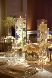 Vase And Candle Centerpieces by Floating Candle Centerpieces With Blush Orchids And Rose Gold