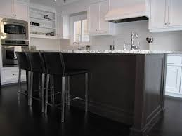 Black And White Kitchen Transitional Kitchen by Dark Floor And Island With Contrasting Counter And Cabinets Home