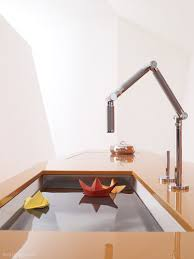articulating kitchen faucet kohler launches breakthrough karbon articulating kitchen faucet