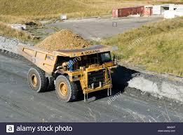 a full dump truck drives up the haul road at frasers pit open cast