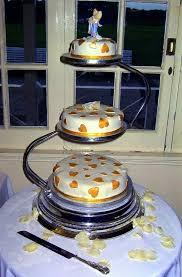 golden hearts covered round 3 tier wedding cake