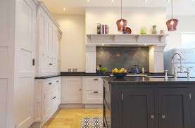 bramhall lewis alderson the range cooker was placed at the centre of one wall framed by a hand made chimney breast to add focal interest a large central island provides plenty of